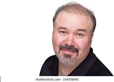 Middle aged man with his goatee looking at camera trustfully and satisfied