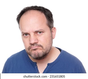 middle aged man looking skeptical and unhappy
