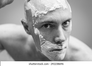 Middle aged man shaving