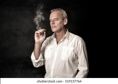 Middle aged man smoking a cigar
