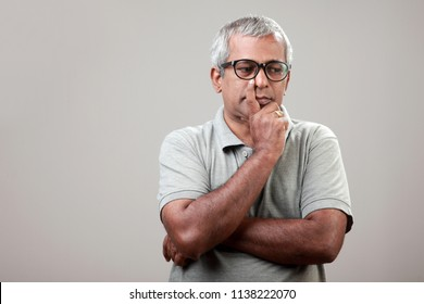 Middle aged man with a thinking face