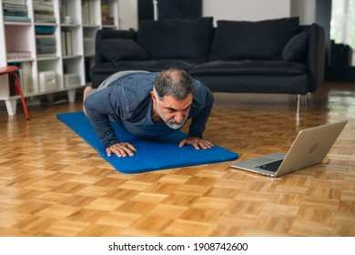 middle aged man training in his home