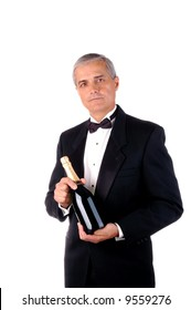 Middle aged Man in Tuxedo Holding a Champagne Bottle over a white background.