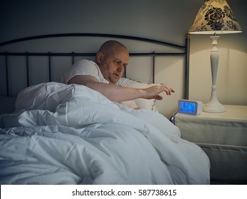 Middle aged man wakes up in the morning