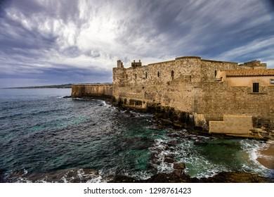 Middle Aged Maniace Castle on seacoast in island of Ortigia on Sicily, Siracusa.
