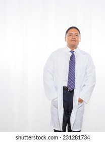 Middle aged professional hispanic male wearing a lab coat