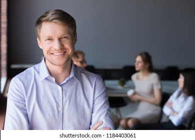 Middle aged smiling company ceo, happy team leader or successful business man looking at camera posing in office, happy professional manager, confident coach or friendly male boss headshot portrait