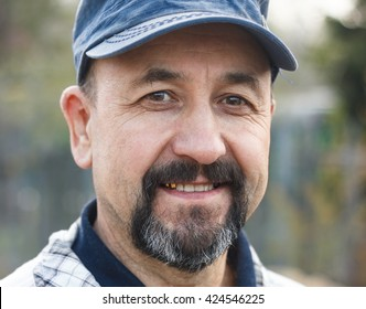 Middle aged smiling man outdoor