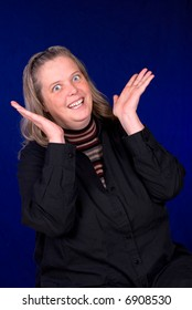 Middle aged Surprised woman over a blue gradient background