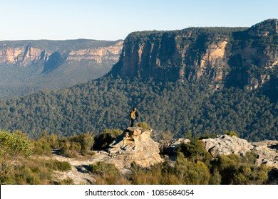 Middle aged tourist overlooking the Blue Mountains in NSW Australia. Beautiful mountains with cliffs and green forest.
