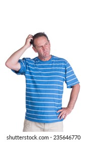 Middle aged white man in a blue striped shirt thinking or scratching his head