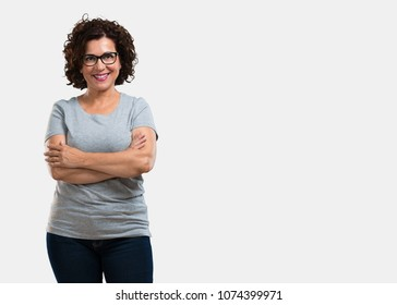 Middle aged woman crossing his arms, smiling and happy, being confident and friendly