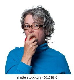 Middle aged woman eating a fresh organic apple