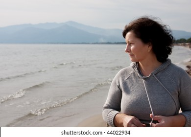 Middle aged woman enjoying a day outdoor at the beach