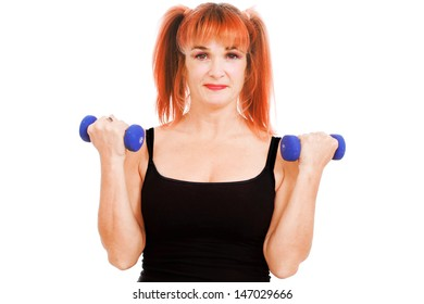 Middle aged woman exercises