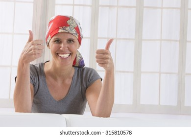 middle aged woman with headscarf having thumb up