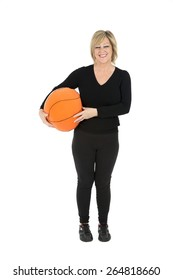 Middle aged woman holding a basketball ball against a white background