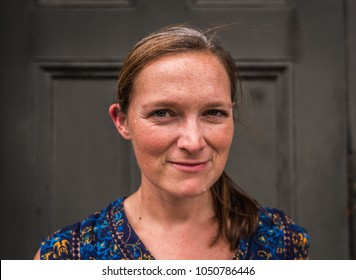 Middle Aged Woman with Natural Look  Smiles at Camera