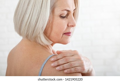 Middle aged woman with a pain in the body. Concept photo with indicating location of the pain. Health care concept