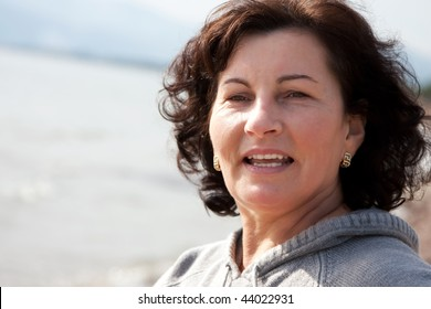 Middle aged woman portrait on the beach