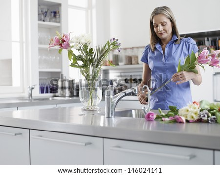 Middle aged woman preparing