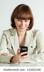 Middle aged woman reading message on her smartphone