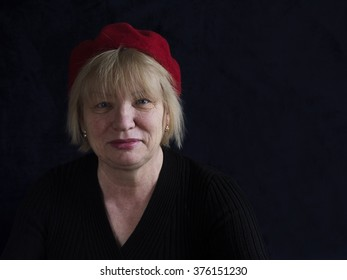 middle aged woman in red beret
