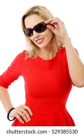 middle aged woman in red dress with sunglasses