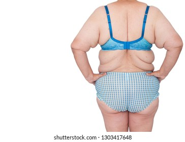 Middle aged woman with sagging skin after babies and extreme weight loss back view hands on hips, copy space left. Before brachioplasty, panniculectomy, abdominoplasty and mummy makeover.