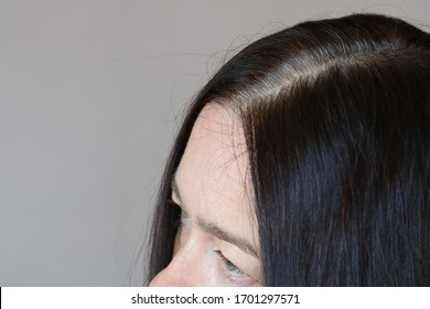 Middle aged woman Serious and Stressed effected to headache and gray hair on white background