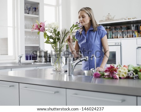 Middle aged woman smelling