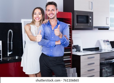 middle class happy family selecting modern kitchen furniture