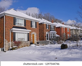 middle class residential street with brick houses in winter