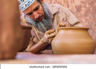 Middle East, Arabian Peninsula, Oman, Ad Dakhiliyah, Bahla. Oct. 23, 2019. Man working at a potter's wheel at the Aladawi pottery factory in Oman.