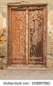 Middle East, Arabian Peninsula, Oman, Al Batinah South, Sur. Old wooden door on a building in Oman.