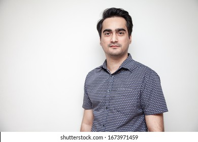 Middle East Asian man dressed casually for office work.