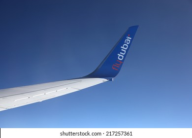 MIDDLE EAST - MAY 26: Wing of the FlyDubai airplane during a flight. May 26, 2011 in the Middle East