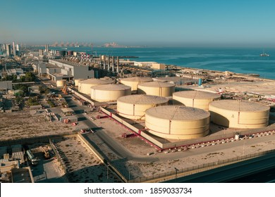 Middle East water and gas containers along the coastline for gas, water and oil concepts. Industrial zone. - Shutterstock ID 1859033734