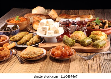 Middle eastern or arabic dishes and assorted meze, concrete rustic background. sambusak. Turkish Dessert Baklava with pistachio. Sarma, Rice and mint wrapped in grape vine leaves. Halal food. Lebanese