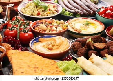 Middle eastern or arabic dishes and assorted meze, concrete rustic background. Falafel. Turkish Dessert Baklava with pistachio. Middle eastern or arabic dishes and assorted