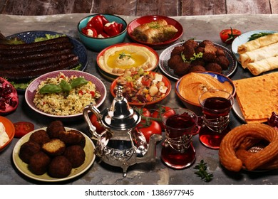 Middle eastern or arabic dishes and assorted meze, concrete rustic background. Falafel. Turkish Dessert Baklava with pistachio. Middle eastern or arabic dishes and assorted meze, concrete rustic