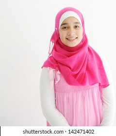 Middle eastern Arabic girl wearing pink hijab scarf on white