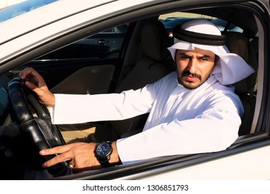 Middle Eastern Arabic man driving a car  wearing traditional dishdasha kandora menswear