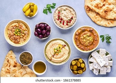 Middle eastern, arabic traditional breakfast with hummus, foul, mutabbal, qudsia and zaatar. Top view
