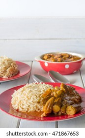Middle Eastern Bamiya and Rice on White Table Vertical with Copy Space