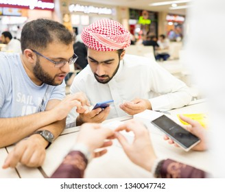Middle eastern boys with smart phone