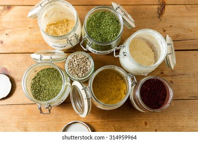 Middle Eastern cuisine: jars of spices and dried herbs ready to be used. Powdered ginger and garllic, cumin, dried parsley and mint, sumac and sunflower seeds.