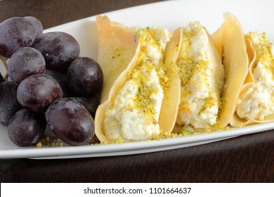 Middle Eastern dessert served after the fast during Ramadan is a sweet pancake filled with ricotta cheese, orange blossom water and grated rind, garnished with ground pistachios