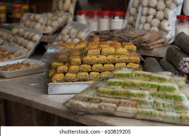 Middle Eastern Desserts.Arabic Sweets. Lebanese sweets-Dough Balls in Syrup.Baklava with chopped nuts , sweetened  with syrup or honey.Fruit leather.