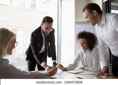 Middle eastern ethnicity chief financial officer and diverse corporate partners handles company finances gathered together at conference room reached positive results, teamwork and cooperation concept